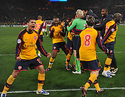 The Arsenal players celebrate after the UEFA Champions League shoot-out, Round of Last 16, Second Leg match between AS Roma and Arsenal at the Stadio Olimpico on March 11, 2009 in Rome, Italy.