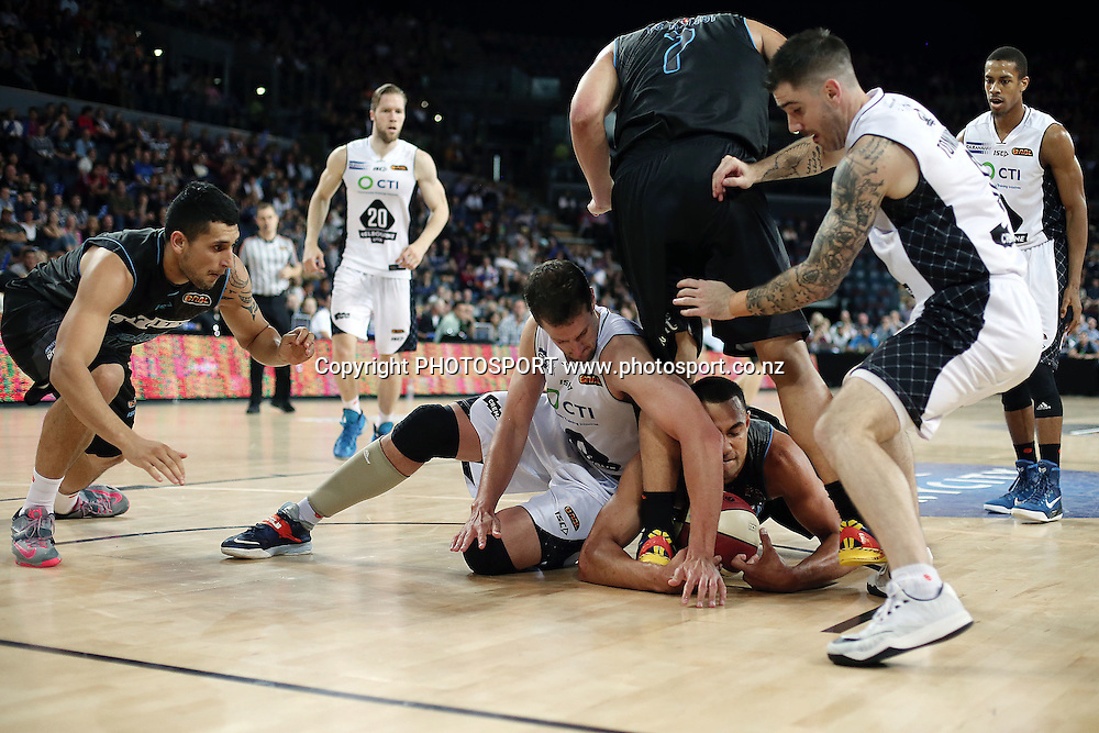Mika Vukona of the Breakers dives for a loose ball against Daniel Kickert of Melbourne United. 2014/15 ANBL, SkyCity Breakers vs Melbourne United, Vector Arena, Auckland, New Zealand. Friday 21 November 2014. Photo: Anthony Au-Yeung / photosport.co.nz