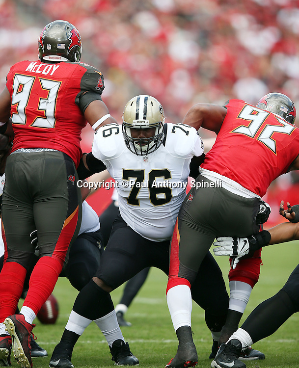 New Orleans Saints offensive tackle Tony Hills (76) blocks Tampa Bay Buccaneers defensive tackle Gerald McCoy (93) and Tampa Bay Buccaneers defensive end William Gholston (92) on a field goal attempt during the 2015 week 14 regular season NFL football game against the Tampa Bay Buccaneers on Sunday, Dec. 13, 2015 in Tampa, Fla. The Saints won the game 24-17. (©Paul Anthony Spinelli)