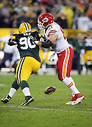 Kansas City Chiefs center Mitch Morse (61) blocks Green Bay Packers nose tackle B.J. Raji (90) as a live ball hits the ground during the 2015 NFL week 3 regular season football game against the Green Bay Packers on Monday, Sept. 28, 2015 in Green Bay, Wis. The Packers won the game 38-28. (©Paul Anthony Spinelli)