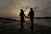 Polish couple watching the sun go down on Galway Bay on ew Years Day. Photo:Andrew Downes