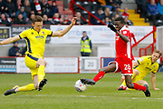 Crawley Town forward Panutche Camara (28) stretches to keep the ball away from Cheltenham Town defender William Boyle (15) during the EFL Sky Bet League 2 match between Crawley Town and Cheltenham Town at the Checkatrade.com Stadium, Crawley, England on 24 March 2018. Picture by Andy Walter.
