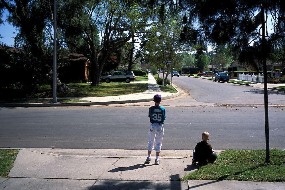 Trevor and Andrew can't wait for their homeschooled friends to arrive for a joint art lesson, so they stand by the street watching for their car to arrive.