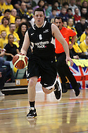 Guildford, England, Sunday 21st March 2010:  Andrew Bridge of Newcastle runs with the ball during the  BBL Trophy Final between Cheshire Jets and Newcastle Eagles at the Guildford Spectrum, Surrey, UK. Final score Cheshire 95-111 Newcastle.  (photo by Andrew Tobin/SLIK images)
