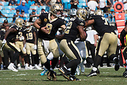 Drew Brees(9) has off to Mark Ingram(22) in the New Orleans Saints 34 to 13 victory over the Carolina Panthers.