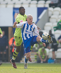 COLCHESTER, ENGLAND - Saturday, April 24, 2010: Tranmere Rovers' Bas Savage and Colchester United's Marc Tierney in action during the Football League One match at the Western Community Stadium. (Photo by Gareth Davies/Propaganda)