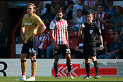 Thinking he was in the clear, Nottingham Forest defender Michael Hefele (9) walks away from the referee and Brentford defender Yoann Barbet (29). Both players were booked for an altercation during the EFL Sky Bet Championship match between Brentford and Nottingham Forest at Griffin Park, London, England on 1 September 2018.