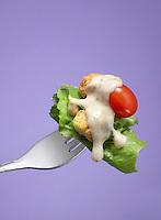 bite of salad on a fork