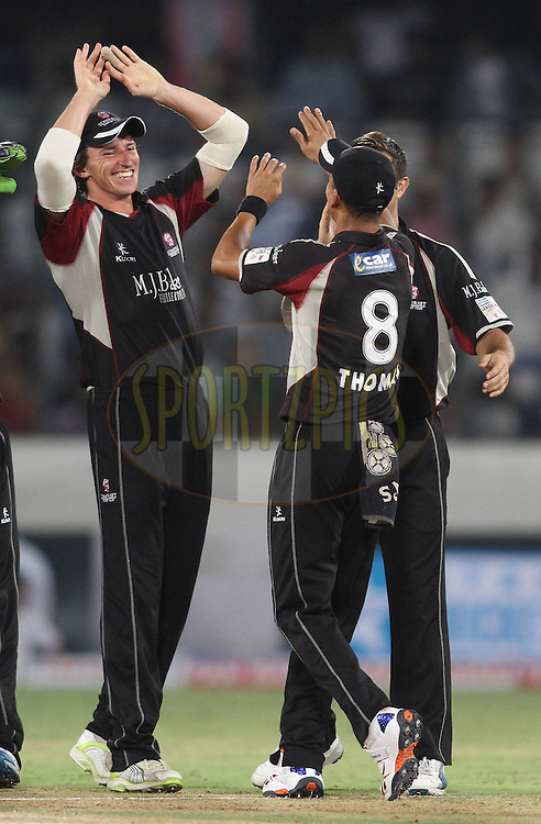 Somerset celebrate a wicket during Match 5 of the NOKIA CLT20 between The Kolkata Knight Riders and Somerset held at the Rajiv Gandhi International Stadium, Hyderabad on the 25th September 2011..Photo by Shaun Roy/BCCI/SPORTZPICS