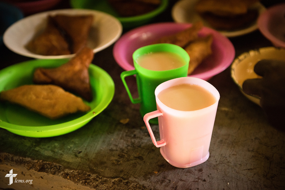 Tea and Mandazi, similar to a doughnut, is served as a snack to young men at the Othoro ELCK (Evangelical Lutheran Church in Kenya) Project 24 boarding facility on Sunday, Oct. 18, 2015, in Kisumu, Kenya. LCMS Communications/Erik M. Lunsford
