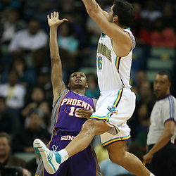 Peja Stojakovic #16 gets off a shot for the New Orleans Hornets against the Phoenix Suns on February 26, 2008 at the New Orleans Arena in New Orleans, Louisiana. The New Orleans Hornets defeated the Phoenix Suns 120-103.
