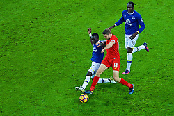 LIVERPOOL, ENGLAND - Monday, December 19, 2016: Liverpool's captain Jordan Henderson in action against Everton's Idriss Gana Gueye and Romelu Lukaku during the FA Premier League match, the 227th Merseyside Derby, at Goodison Park. (Pic by Gavin Trafford/Propaganda)