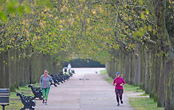 ©Licensed to London News Pictures 31/03/2020  <br /> Greenwich, UK. Social distancing joggers. People get out of the house from Coronavirus lockdown to exercise in Greenwich Park, London. The Prime Minister Boris Johnson has asked people to stay at home to help in the fight against Covid-19 and to only go out for essential reasons. credit:Grant Falvey/LNP
