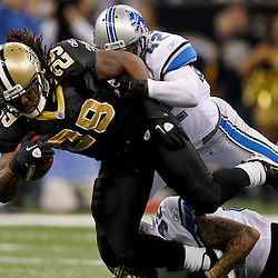 January 7, 2012; New Orleans, LA, USA; New Orleans Saints running back Chris Ivory (29) is tackled by Detroit Lions cornerback Aaron Berry (32) during the 2011 NFC wild card playoff game at the Mercedes-Benz Superdome. Mandatory Credit: Derick E. Hingle-US PRESSWIRE