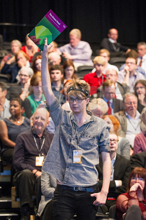 © Licensed to London News Pictures . 25/09/2013 . Brighton , UK . Members of the crowd attempt to draw Ed Miliband 's eye during the Q&A this afternoon (Wednesday 25th September 2013) . Day 4 of the Labour Party 's annual conference in Brighton . Photo credit : Joel Goodman/LNP
