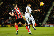 Darren Bent beats Steve Cook to the ball during the Sky Bet Championship match between Bournemouth and Derby County at the Goldsands Stadium, Bournemouth, England on 10 February 2015. Photo by Adam Rivers.