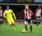 Brentford midfielder Ryan Woods driving into the middle of the park during the Sky Bet Championship match between Brentford and Nottingham Forest at Griffin Park, London, England on 21 November 2015. Photo by Matthew Redman.