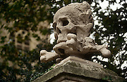 A detail of the Skull and Crossbones on the gates of St Nicholas Church, Deptford, London - thought to have been the inspiration for Captain Morgan's pirate flag. .This church is a short walk down from the ship yards on the Thames. The sailors would come here to pray before embarking on a new voyage. Some of their voyages were to plunder from any ship they found on the high seas. Since they could not fly the flag of their nationality they chose to fly the Skull and Crossbones flag of St. Nicholas, that way other Deptford ships would not attack them.