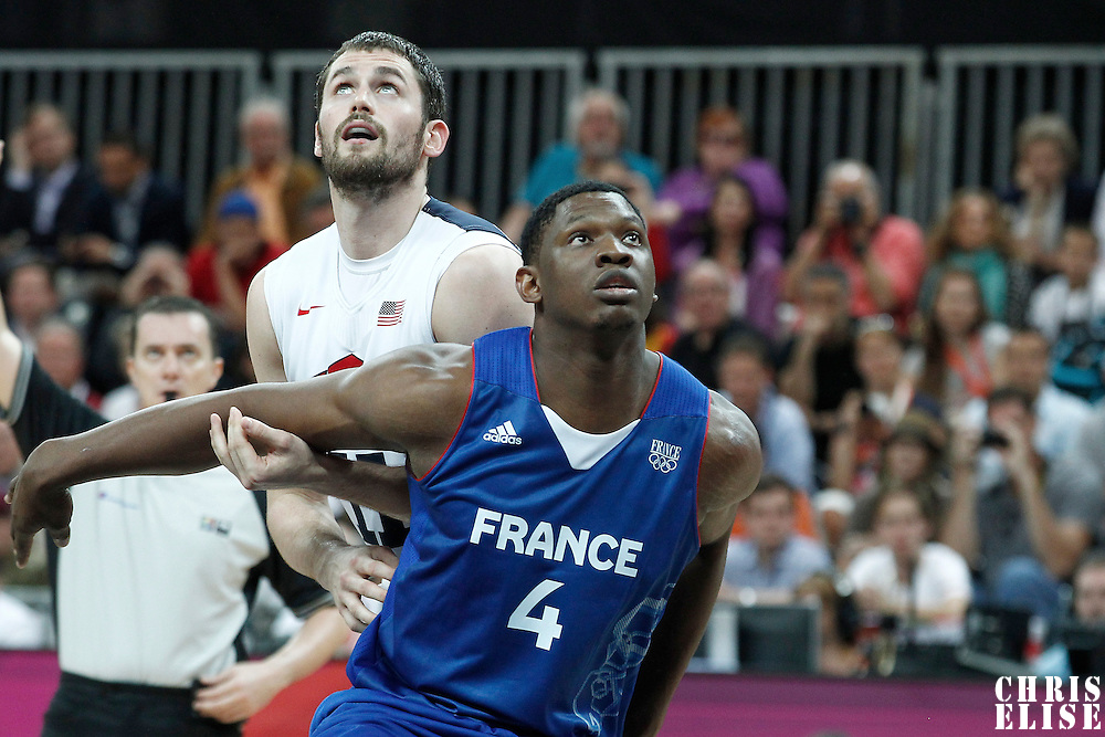 29 July 2012: USA Kevin Love vies for the rebound with Kevin Seraphin of France during the 98-71 Team USA victory over Team France, during the men's basketball preliminary, at the Basketball Arena, in London, Great Britain.