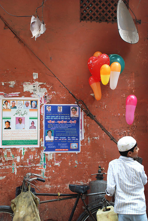 A young boy sells balloons on the streets of Old Delhi