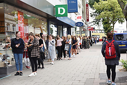 © Licensed to London News Pictures. 15/06/2020. Brighton, UK. People queue round the block as a Primark store opens in Brighton, in East Sussex.  New rules allowing some non-essential retail businesses to open and mandatory face masks on public transport have started today.  Photo credit: Liz Pearce/LNP