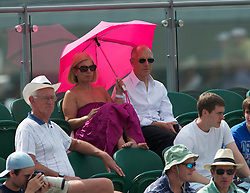 LONDON, ENGLAND - Friday, June 25, 2010: Spectators shelter from the sun with an umbrella during the Gentlemen's Singles 3rd Round on day five of the Wimbledon Lawn Tennis Championships at the All England Lawn Tennis and Croquet Club. (Pic by David Rawcliffe/Propaganda)