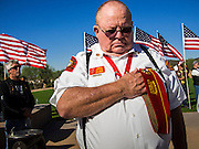 08 OCTOBER 2013 - PHOENIX, AZ:  A US military veteran bows his head in prayer at a ceremony interring the cremated remains of unclaimed US military veterans at the National Memorial Cemetery in Phoenix. The cremated remains of 36 unclaimed US military veterans were interred at the National Memorial Cemetery in Phoenix. Members of the US military and several hundred veterans of the US military attended the service, which was a part of the Missing In America Project (MIAP).   PHOTO BY JACK KURTZ