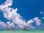 Mokolua Islands float in a turquoise sea off of Lanikai Beach on Oahu, Hawaii