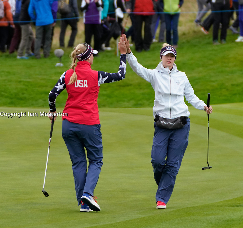 Auchterarder, Scotland, UK. 14 September 2019. Saturday morning Foresomes matches  at 2019 Solheim Cup on Centenary Course at Gleneagles. Pictured;  Nelly Korda (r) and Jessica Korda of Team USA fist pump on 2nd green. Iain Masterton/Alamy Live News