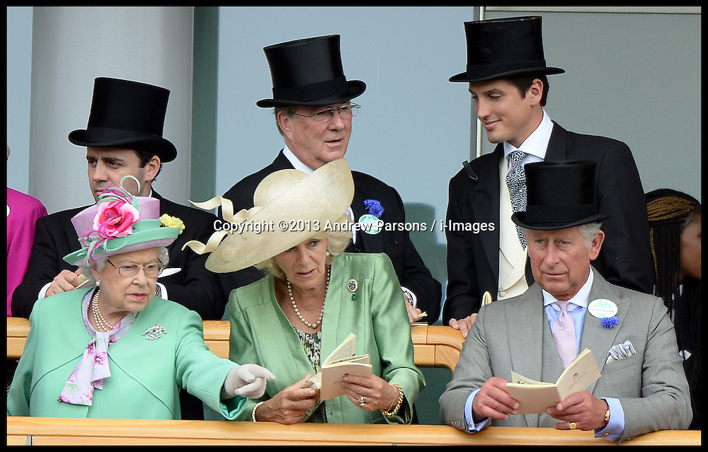 HM The Queen with Prince Charles, The Duchess of Cornwall  look at horses in the parade ring from the royal box at Royal Ascot 2013<br /> Ascot, United Kingdom<br /> Wednesday, 19th June 2013<br /> Picture by Andrew Parsons / i-Images