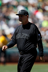 OAKLAND, CA - AUGUST 25:  Bruce Bochy #15 of the San Francisco Giants returns to the dugout after making a pitching change during the fifth inning against the Oakland Athletics at the RingCentral Coliseum on August 25, 2019 in Oakland, California. The San Francisco Giants defeated the Oakland Athletics 5-4. Teams are wearing special color schemed uniforms with players choosing nicknames to display for Players' Weekend. (Photo by Jason O. Watson/Getty Images) *** Local Caption *** Bruce Bochy