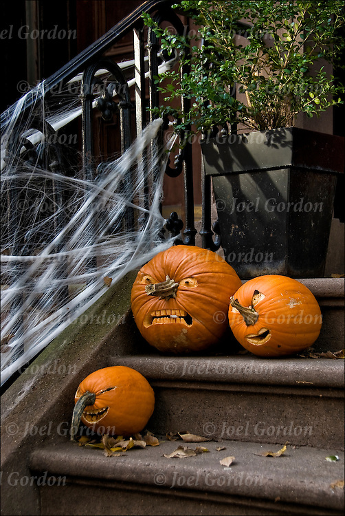 Halloween Decorations in Greenwich Village. Carved pumpkin on door steps made into Jack-0'-Lantrens and other decorations.