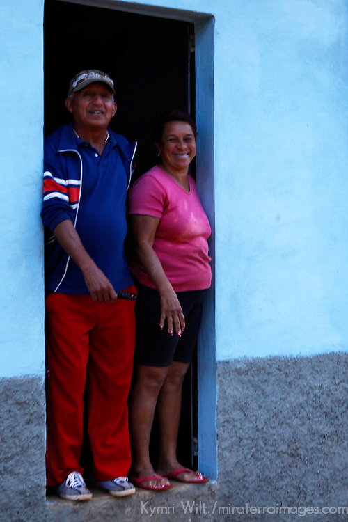 Central America, Cuba, Remedios. Cuban couple standing in doorway.