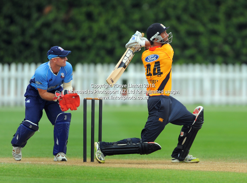 Wellington captain Grant Elliott hits out to be caught as Gareth Hopkins looks on. One Day cricket - Wellington Firebirds v Auckland Aces at Allied Nationwide Finance Basin Reserve, Wellington on Wednesday, 2 February 2011. Photo: Dave Lintott / photosport.co.nz