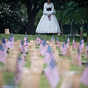 "Harriette Matthews stands as a civilian reenactor at the Soldiers National Cemetery, during the Sesquicentennial Anniversary of the Battle of Gettysburg, Pennsylvania on Sunday, June 30, 2013.   Following ""A New Birth of Freedom"" program at Meade's Headquarters, a procession by candlelight was led to the cemetery. John Boal photography"