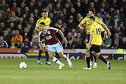 Andre Gray of Burnley tries to get away from Stewart Downing of Middlesbrough during the Sky Bet Championship match between Burnley and Middlesbrough at Turf Moor, Burnley, England on 19 April 2016. Photo by Simon Brady.