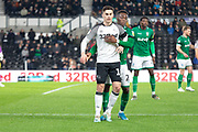 Derby County's Tom Lawrence (10) & Sheffield Wednesday's Moses Odubajo (22) during the EFL Sky Bet Championship match between Derby County and Sheffield Wednesday at the Pride Park, Derby, England on 11 December 2019.