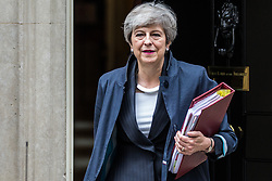 London, UK. 26 June, 2019. Prime Minister Theresa May leaves 10 Downing Street to attend Prime Minister's Questions in the House of Commons, before travelling to Manchester for a speech at the Chartered Institute of Housing conference. Credit: Mark Kerrison/Alamy Live News