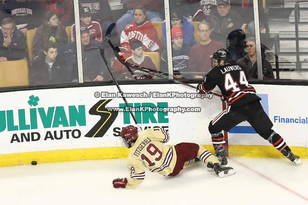 Dax Lauwers #44 of the Northeastern Huskies and Ryan Fitzgerald #19 of the Boston College Eagles fight for the puck during The Beanpot Championship Game at TD Garden on February 10, 2014 in Boston, Massachusetts. (Photo by Elan Kawesch)