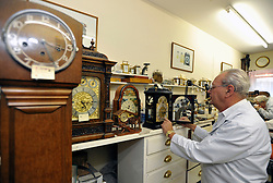 "©London News pictures...28/10/2010.  Staff at Horological Workshops start the task of changing the 100's of clocks at their store in Guildford, Surrey, UK. Micahel Tooke who has owned the store for 43 years and worked in the clock business all his life said. ""at this time of year we get alot of people who bring clocks in for repair after they have changed the time incorreectly by winding back the hands manually"""