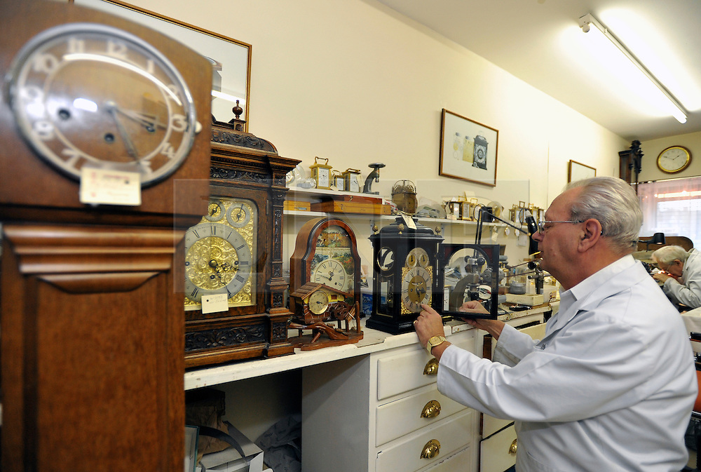 """©London News pictures...28/10/2010.  Staff at Horological Workshops start the task of changing the 100's of clocks at their store in Guildford, Surrey, UK. Micahel Tooke who has owned the store for 43 years and worked in the clock business all his life said. """"at this time of year we get alot of people who bring clocks in for repair after they have changed the time incorreectly by winding back the hands manually"""""""