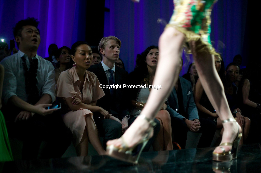 BEIJING, MAY 11, 2012 : Maximilian Johnson, younger brother of London's mayor Boris Johnson, watches a Jean-Paul Gaultier fashion show in Beijing.