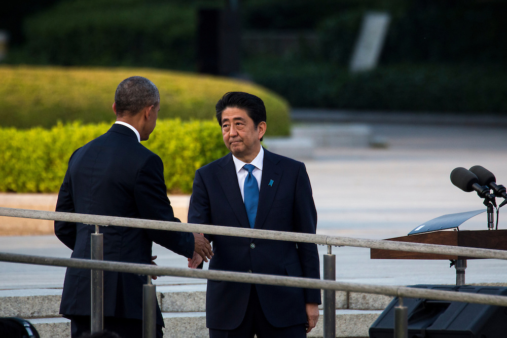 HIROSHIMA, JAPAN - MAY 27 : U.S. President Barack Obama (left) shake hands with Prime Minister Shinzo Abe (right) in front of cenotaph in the Hiroshima Peace Memorial Park in Hiroshima, Japan on May 27, 2016.<br /> US President Barack Obama is the first American president to visit Hiroshima after United States of America dropped Atomic bomb in Hiroshima on August 6, 1945.<br /> <br /> Photo: Richard Atrero de Guzman<br /> <br />  <br /> <br /> <br /> <br /> <br /> <br /> Photo: Richard Atrero de Guzman