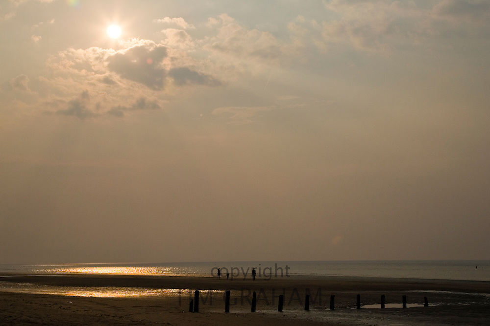 Family play on the Brancaster beach, North Norfolk, United Kingdom