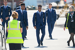 © Licensed to London News Pictures. 06/06/2016. Luton, UK. HARRY KANE, KYLE WALKER, DANIEL STURRIDGE, RAHEEM STERLING and  and JACK WILSHIRE  join other members of England national football squad as they board a plane at Luton airport in Bedfordshire, England, to head for their training camp in France, ahead of the start of the UEFA Euro 2016 championships.  Photo credit: Ben Cawthra/LNP