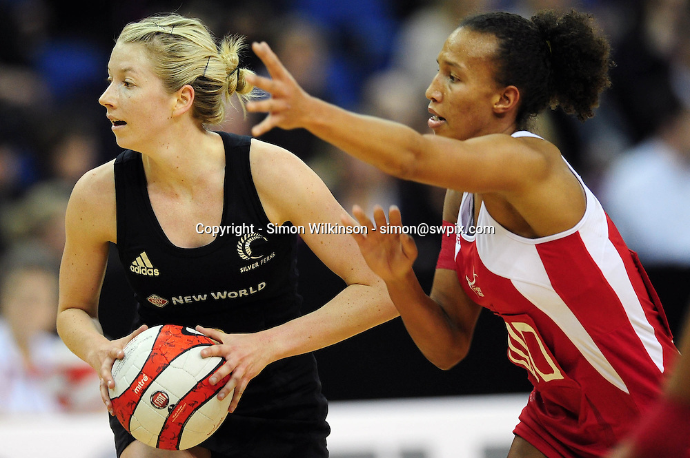 PICTURE BY ALEX BROADWAY/SWPIX.COM. Netball -  Fiat International Netball Series - England v New Zealand - The 02 Arena, London, England - 19/01/11.<br /><br />Serena Guthrie of England &amp; Camilla Lees of New Zealand.