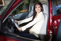 Portrait of a woman taking a test drive