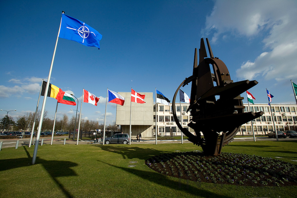 BRUSSELS - BELGIUM - 06 MARCH 2009 --  The NATO Headquarters with the big sculpture and the flags of the 26 NATO member countries outside the grass lawn in front of the main entrance.  Photo: Erik Luntang