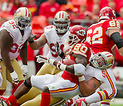KANSAS CITY, MO - SEPTEMBER 26:   Justin Smith #94 of the San Francisco 49ers tackles Thomas Jones #20 of the Kansas City Chiefs at Arrowhead Stadium on September 26, 2010 in Kansas City, Missouri.  The Chiefs defeated the 49ers 31-10.  (Photo by Wesley Hitt/Getty Images) *** Local Caption *** Justin Smith; Thomas Jones
