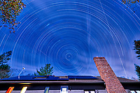 Startrails looking north (light clouds). The north star isn't exactly due north. Composite of 130 images taken with a Nikon D810a camera and 14-24 mm f/2.8 lens (ISO 200, 14 mm, f/8, 300 sec).